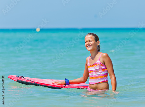 Cute girl with surfboard