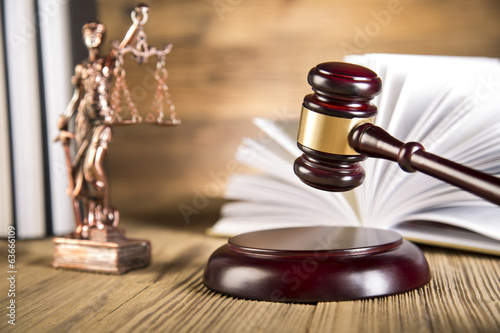 Lady of justice, wooden & gold gavel and books on wooden table - 63666109