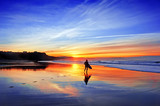 surfer in beach at sunset