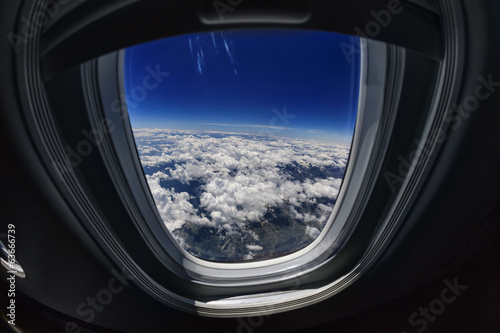 Italy, aerial view of clouds from an airplane window