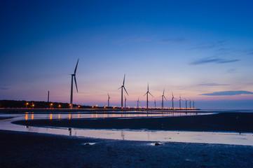 Wind turbine array at seashore wetland