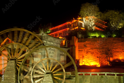 Water wheel ,landmark of Lijiang Dayan old town at night.