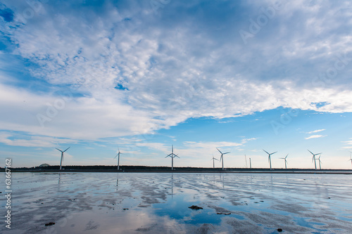 Wind turbine array at seashore wetland