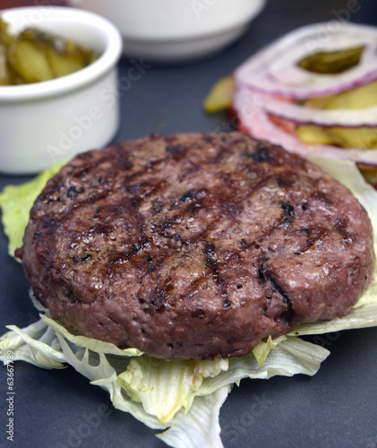 Open burger with lettuce leaves