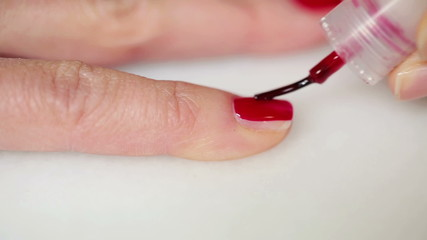Close up shoot of woman painting her nail