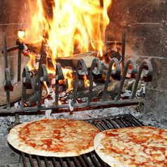 pizza baked in a wood fireplace with a wood-burning oven 3