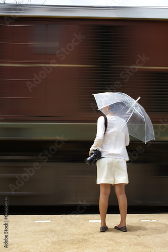 girl and moving train in thailand