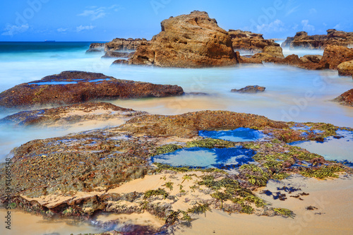 Long exposure rocks and rock pools at low tide