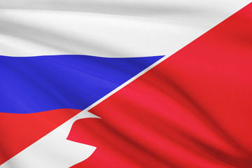 Series of ruffled flags. Russia and Bahrain.
