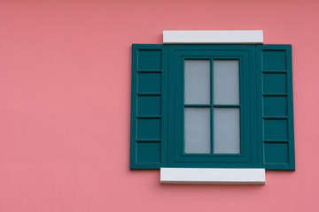 Green window on the pink wall.