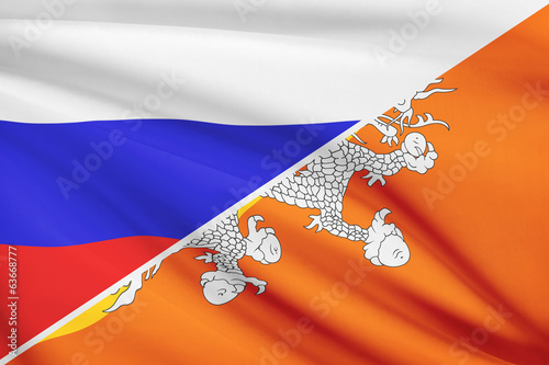 Series of ruffled flags. Russia and Bhutan.