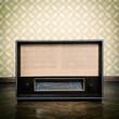 vintage radio receiver device on the weathered wooden parquet fl