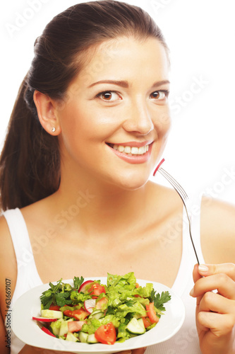 young woman eating salat