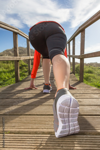 Female legs with running shoes ready to training
