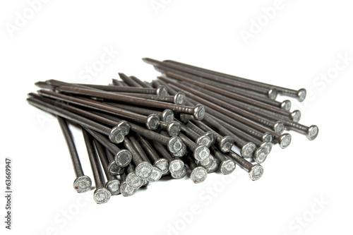 Closeup View of Piled Wire Nails on White