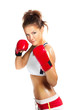 boxer woman during boxing exercise in defence position with red