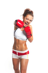 boxer woman during boxing exercise making direct hit with red gl