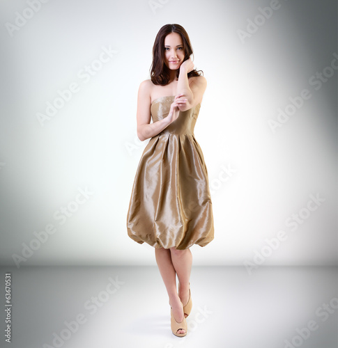 Beautiful young woman posing at studio
