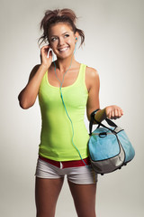 athletic girl with a bag with headphones