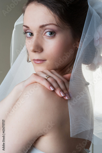 Portrait of beautiful bride woman with veil