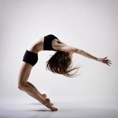 young beautiful dancer teen girl dancing and jumping, studio ser