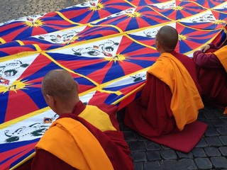 Tibetan monks with flag