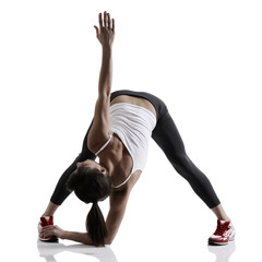portrait of sport girl doing yoga stretching exercise, studio sh