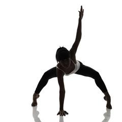 portrait of sport girl doing yoga stretching yoga exercise, stud