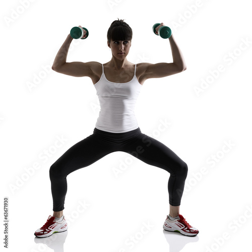 sport girl doing with exercise dumbbells, fitness woman studio s