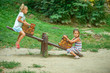 Two sisters ride on swings