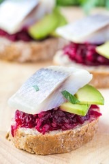 Canape herring with beets on rye toast, tasty starter, appertise