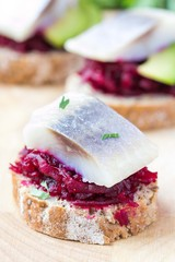 Canape herring with beets on rye toast, appetizer for vodka
