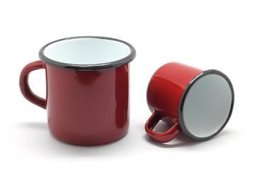 Enamel mugs isolated on white background