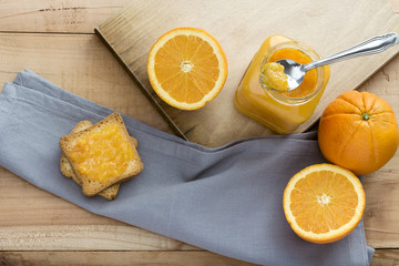 Toast and orange jam on Wooden table
