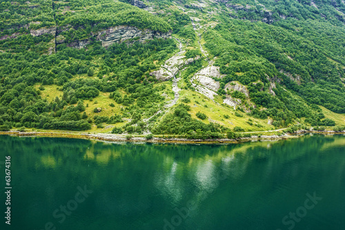 Green coast in summer, Geiranger, Norway.