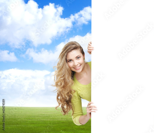 Girl with a blank banner. Perfect space to put any text.