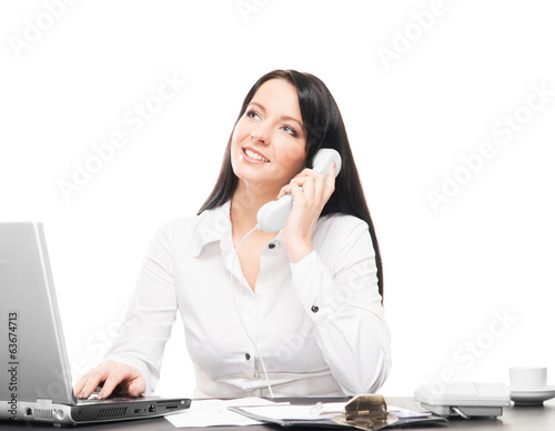 A businesswoman working in an office isolated on the phone
