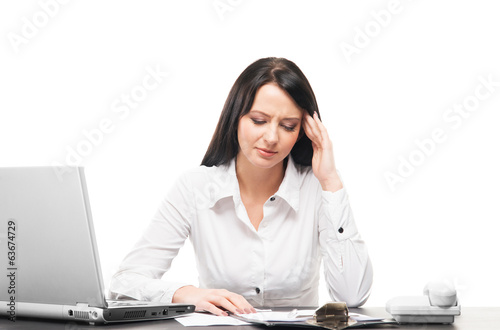 A businesswoman working in an office isolated on white