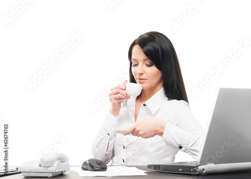A business woman working in an office isolated on white