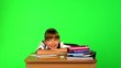 Schoolchild in classroom. Chroma key.