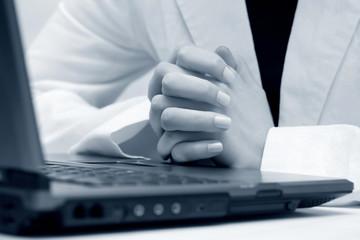 Female hands on laptop