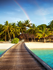Wooden bridge to island beach resort