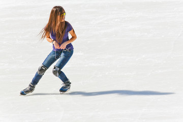 Young girl at the ice rink outdoor
