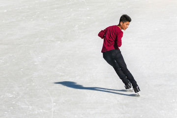 Young boy at the ice rink outdoor