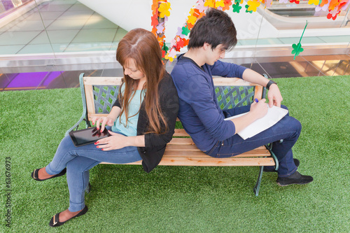 male and female university students sitting
