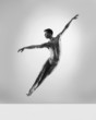 Sporty and athletic ballet dancer. Black and white image.