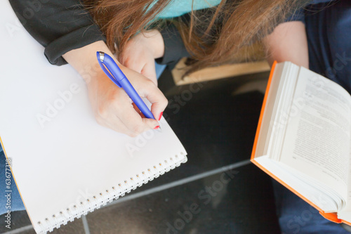 woman's hand with documents and pen