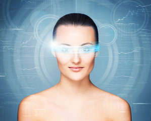 Portrait of a sensual woman with virtual glasses on blue