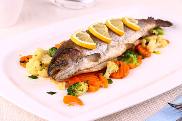 Grilled whole trout, vegetables and lemon