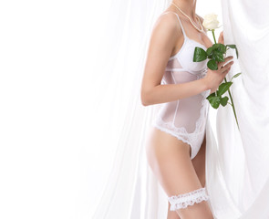 Young sexy bride in erotic lingerie over white